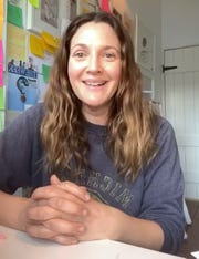 Drew Barrymore wears a vintage-looking University of Michigan sweater in an Instagram live video.