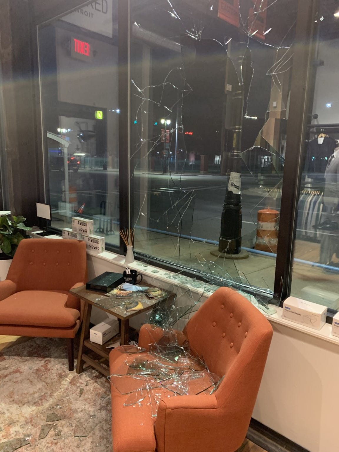 The top of the right armrest of the glass-covered chair was gashed as the window broke. Tailored Detroit owner Warick Richardson says he hasn't decided whether to repair it or leave it as a reminder of the store's resilience.