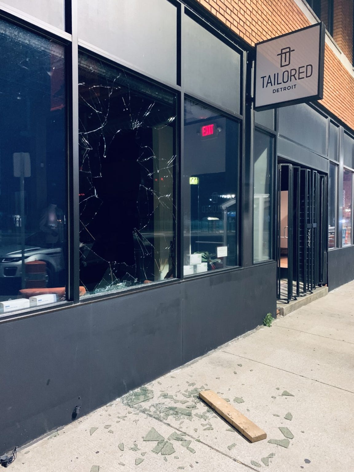 The would-be intruder at Tailored Detroit used a wooden plank and several chunks of concrete to break through a double-paned window.