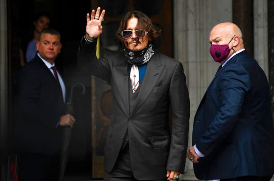 "Johnny Depp arrives at the High Court in London, Wednesday July 8, 2020. Johnny Depp is facing a second day of cross-examination by lawyers for British tabloid The Sun, which is defending a libel claim after calling the Hollywood star a ""wife beater."""