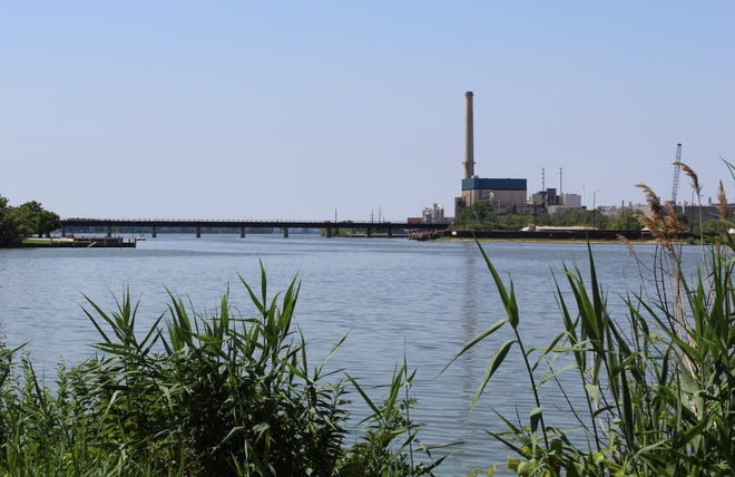 The Georgia-Pacific Broadway Mill's 400-foot tall smokestack can be seen from across the Fox River. Georgia-Pacific plans to turn off its remaining coal-fired boiler Dec. 28 and remove the obsolete stack some time in 2021.