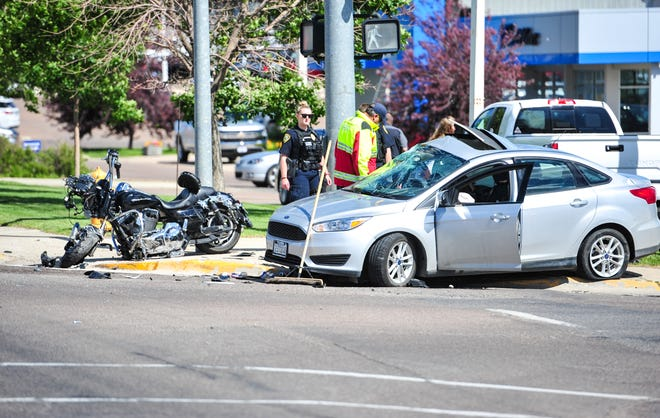 Eastbound lanes of 10th Avenue South were shutdown between 38th Street South and 40th Streets South on Wednesday afternoon after a collision involving a motorcycle and car occurred at the corner of 10th Avenue South and 39th Street South.
