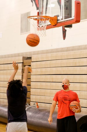 Coach Andy Baker goes through a drill with members of the Lafayette Jeff girls basketball team during a practice inside Denny Blind gymnasium, Tuesday, July 7, 2020, in Lafayette.