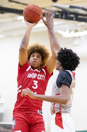 JD Davison (3) shoots over Jonathan Lawson (11) on Wednesday, July 8, 2020, during Hoop City Pro Week at First Assembly Christian School in Cordova.