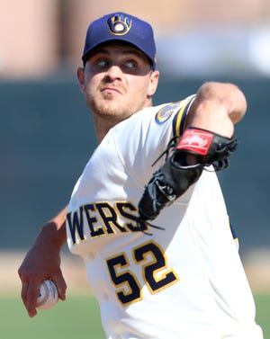 Milwaukee Brewers non-roster invitee Justin Grimm (shown in earlier spring training) pitched in Wednesday's situational scrimmage and has made an impression on manager Craig Counsell.