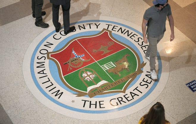 The entrance lobby in the Williamson County courthouse features the Williamson County seal on the floor, which features a Confederate flag.