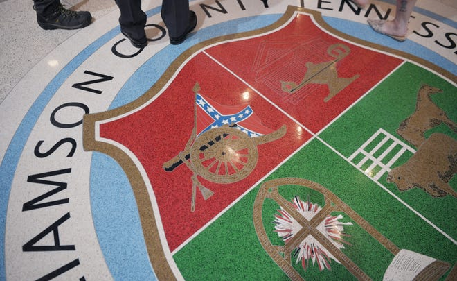 The entrance lobby in the Williamson County Courthouse features the Williamson County seal on the floor, which includes a Confederate flag.