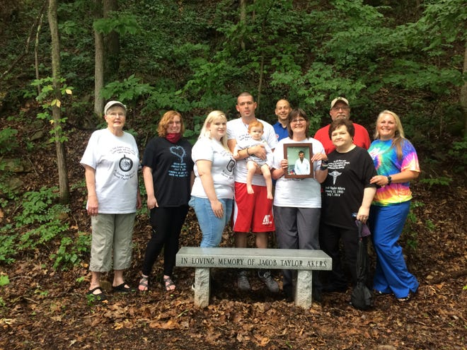The Akers family and others gathered along the Cumberland River Bicentennial Trail, where there is a bench dedicated in memory of Jacob Akers, on Tuesday, July 7, 2020.