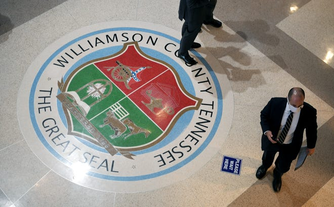 The entrance lobby in the Williamson County courthouse in downtown Franklin features the Williamson County seal on the floor which includes a Confederate flag.
