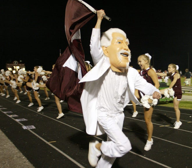 The Franklin High School rebel mascot runs with the school flag after a Franklin touchdown in 2004.