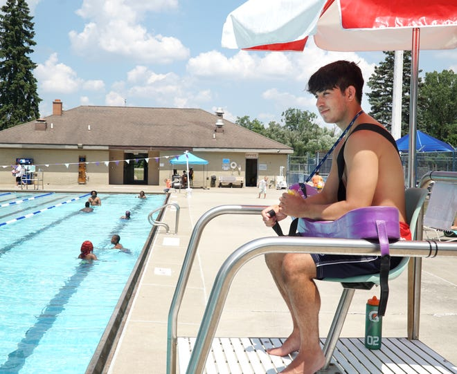 Botsford pool lifeguard Jacob Saucedo watches over swimmers at the Livonia pool on July 8, 2020.