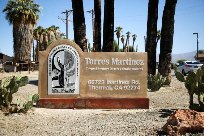A sign for Torres-Martinez Desert Cahuilla Indians sits on tribal land on Tuesday, July 7, 2020 in Thermal, Calif.