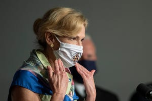 White House coronavirus response coordinator Dr. Deborah Birx wears a mask gifted to her by the Salt River Pima-Maricopa Indian Community during a White House Coronavirus Task Force briefing at the Department of Education building Wednesday, July 8, 2020, in Washington.