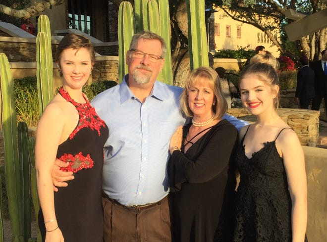 Karen Penn, of Tempe, with her husband, John, and daughters, Taylor, 21, and Sophia, 18.