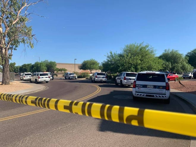 Police investigate a shooting involving officers on July 8, 2020, in Phoenix.