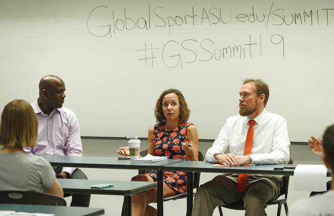 Robert Turner (L) and Victoria Jackson (center) talk with ASU professor Calvin Schermerhorn during a discussion the day before the Global Sports Summit at Arizona State University in Tempe, Ariz. on March 28, 2019.