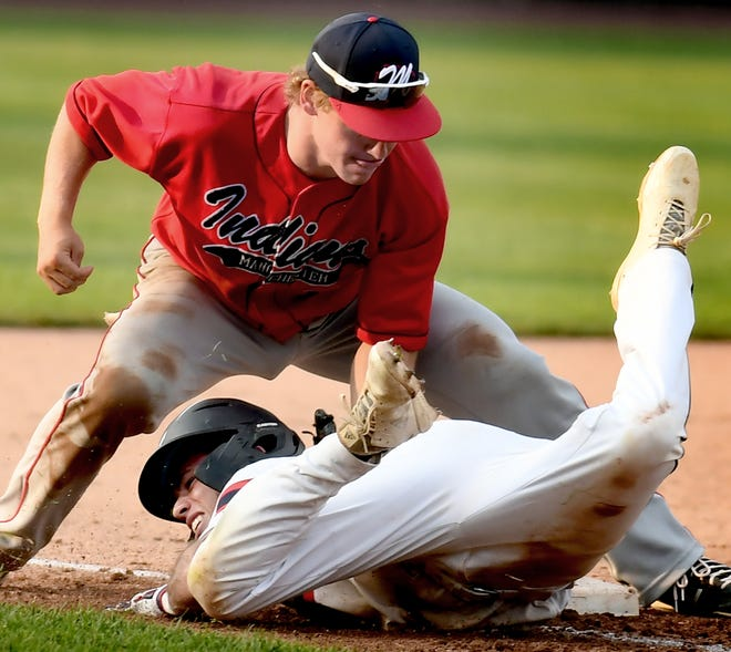 Dillsburg's Dylan Pentz is safe getting back to third after advancing on a teammate's bunt with Manchester's Cole Houser defending in Central League baseball at PeoplesBank Park Tuesday, July 7, 2020. Bill Kalina photo