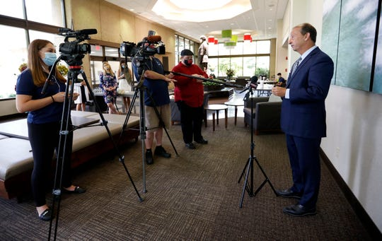 Cox CEO Steve Edwards answers questions at a press conference at Cox South on Wednesday, July 8, 2020.