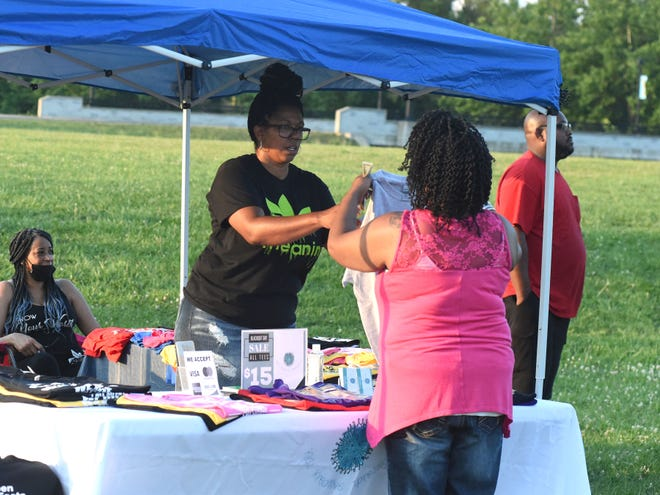 Kiki Scott, owner of KiKi's Kreative Xpressions, had a booth set up at Tuesday's Black Out Expo in Waynesboro's Constitution Park.