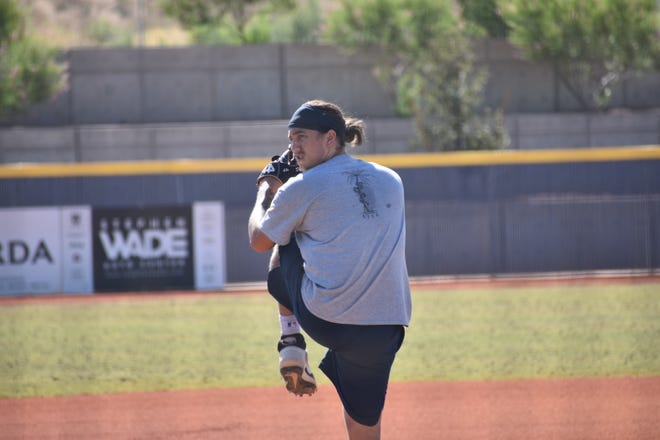 Desert Hills and Dixie State alum Dylan File pitches during his live bullpen session at Crimson Cliffs High School. File will join the Brewers' player pool next Monday to prepare for a chance at the major leagues.