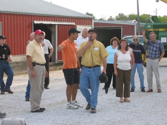 "Scott Gunderson, center in yellow, at a ""Dairy After Hours"" event held at Meadow Brook Dairy Farms in Manitowoc in 2005."