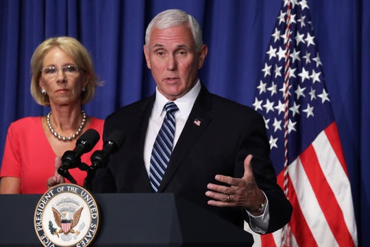 Vice President Mike Pence speaks as Secretary of Education Betsy DeVos listens during a White House Coronavirus Task Force press briefing at the U.S. Department of Education July 8, 2020.