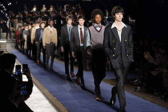 Models showcase suits during a Brooks Brothers fashion show in Italy in 2018.