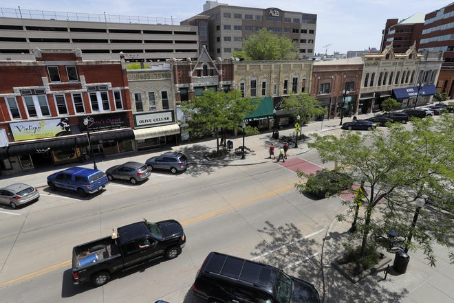 Downtown Neenah could get a second parking ramp in the near future to support development. The existing ramp, shown in the background left of Alta Resources, was built in 2005 and has 950 parking stalls.