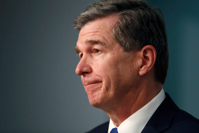Gov. Roy Cooper listens to a question during a briefing at the Emergency Operations Center in Raleigh, N.C., Thursday, July 9, 2020. (Ethan Hyman/The News & Observer via AP)