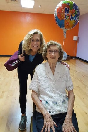 Mary Renfro recently passed away at the age of 99. Mary did her best to never miss a workout throughout her 90s at Cocoa Beach Health and Fitness Center. Here she is seen with instructor Polly Helm.