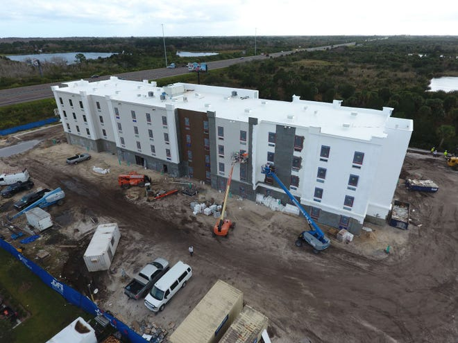 Crews this past winter worked to finish an Extended Stay America hotel near the intersection of Interstate 95 and state Route 50. A spokesperson says the hotel will likely open mid-August.
