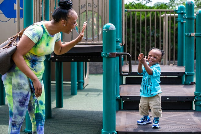 Toya Buckner of Mount Healthy plays with her youngest son Keyon, one-year-old, at Winton Woods Park Thursday, July 9, 2020. Buckner has been involved with Cradle Cincinnati, a collaborative of health and civic partners working together to lower infant mortality in Hamilton County.