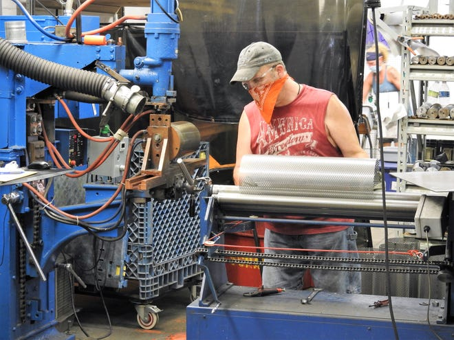 Shane Mitchell makes cores for filters at Ohio Fabricators Company. The company celebrating its 75th anniversary makes filters, strainers and breathers for a wide range of industries. It has about 50 employees and 170 customers around the world.