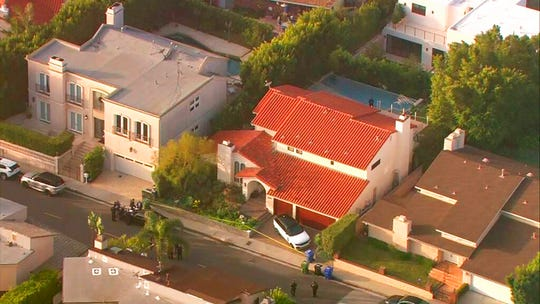 This aerial photo taken from video provided by Fox11 News KTTV-TV shows the Hollywood Hills home, center, where Pop Smoke, 20, was shot and killed early Feb. 19, 2020, in Los Angeles. Authorities say three men and two juveniles have been arrested in connection with the home-invasion death of the rising rapper.