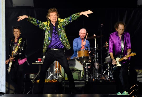 Ron Wood, left, Mick Jagger, Charlie Watts and Keith Richards of the Rolling Stones perform during their concert in Pasadena, Calif.