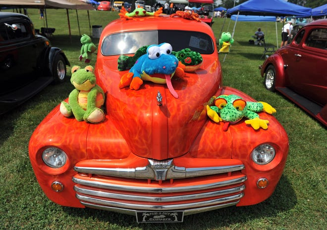 A 1947 Ford Super Deluxe from the Pair-A-Dice Cruizers club, shows off its colorful frogs at the Vanderburgh County 4-H Center at Frog Follies in 2019.