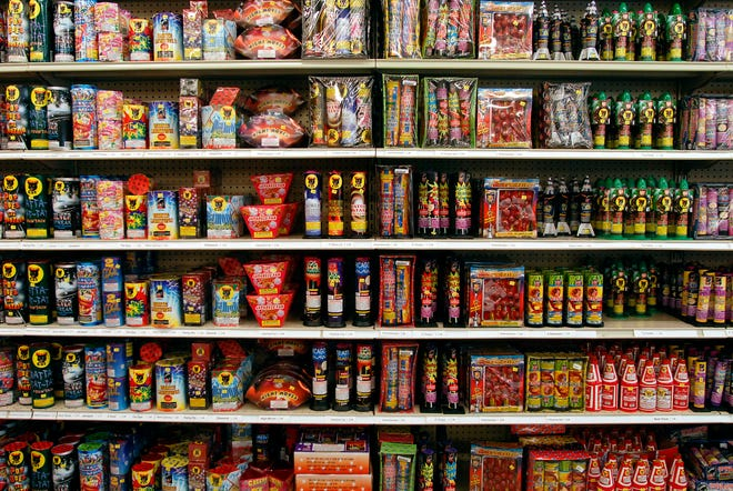 Shelves of fireworks for sale.