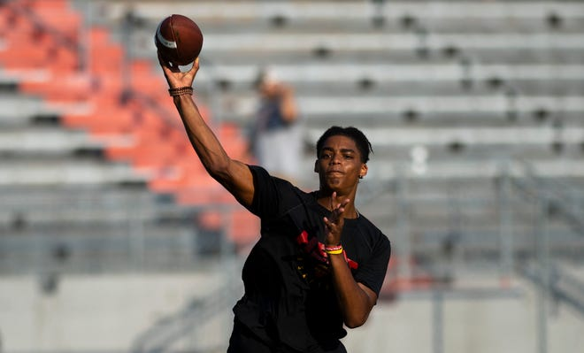 Owensboro Red Devils quarterback Gavin Wimsatt runs through passing drills at Owensboro High School's Rash Stadium Tuesday morning, July 7, 2020. The incoming junior threw for 2,792 yards and 31 touchdowns last season as well as rushing for 564 yards and 12 touchdowns.