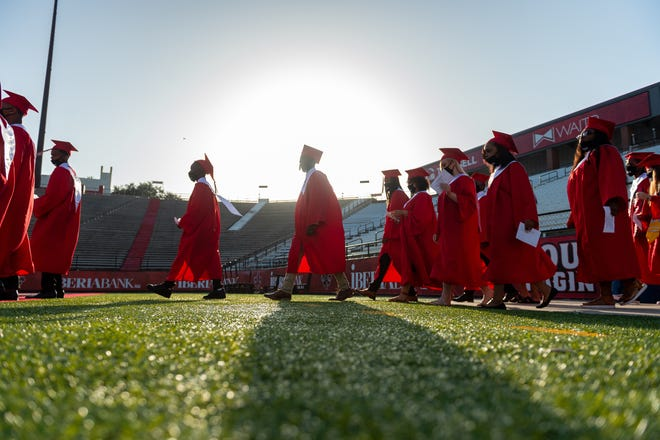 More than 100 seniors from Northside High School celebrated graduation with an early morning ceremony on Cajun Field Thursday, July 9, 2020. The class was the first of eight schools that will mark graduation on the University of Louisiana at Lafayette field this week. Thursday, July 9, 2020.