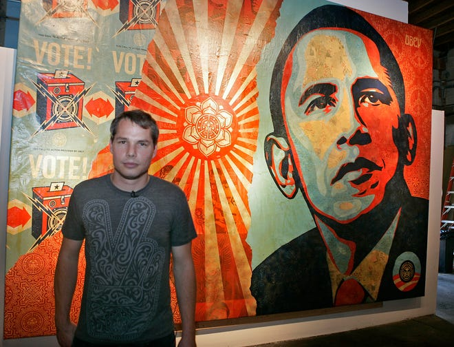 Artist Shepard Fairey displays a portrait of Barack Obama in the Manifest Hope Gallery in Denver, Colorado, in this 2008 file photo.