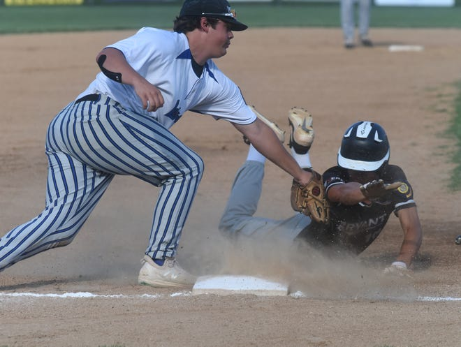 Lockeroom third baseman Will Gross puts a tag on Bryant's Koby Greiner on Wednesday night at Cooper Park.