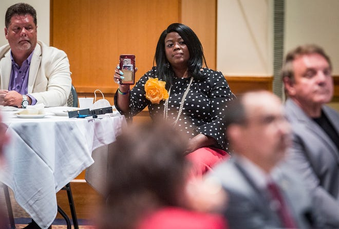 Democrat Jeannine Lee Lake in July tried to engage U.S. Rep. Greg Pence at a Muncie chamber of commerce lunch at which Pence told her it was not a political event.