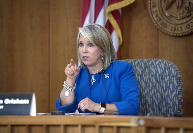 New Mexico Gov. Michelle Lujan Grisham, seen at a July press conference at the state Capitol building in Santa Fe, announced her three appointments to the state's Civil Rights Commission Friday.