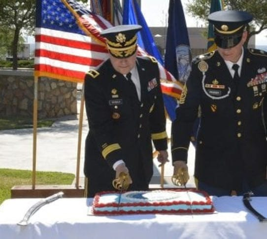 White Sands Missile Range Commander Brig. Gen. David Trybula, left, and Command Sgt. Maj. Christopher Prosser, right, cut the cake during WSMR's 75th Anniversary celebration July 9.