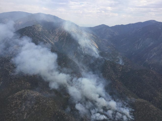 Smoke from the Vics Peak Fire in the Cibola National Forest is visible in San Mateo Canyon July 9, 2020.