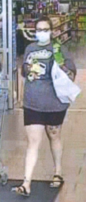 The suspect has a large tattoo on her leg.