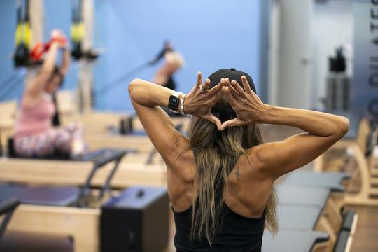 Pilates trainer Ulyssa Preciado leads a Pilates class at Club Pilates in Glendale on June 30, 2020.
