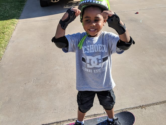 4-year-old Xander Hunter skates down his driveway with his  skateboard he got from the Skate After School program.