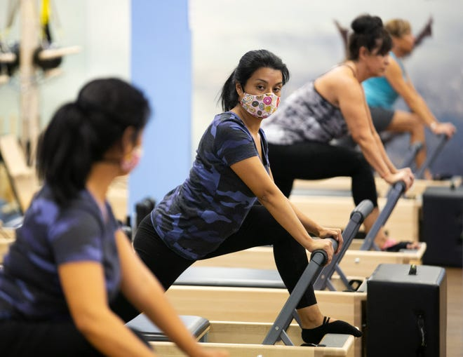 Gabby Banks of Peoria, works out in a Pilates class at Club Pilates in Glendale on June 30, 2020.