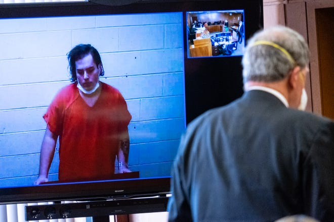 Joseph Gigliotti, 21, of Mt. Clemens, appears on a screen next to his attorney David Heyboer during a probable cause hearing Thursday, July 9, 2020, in front of St. Clair County District Judge Mona Armstrong in the St. Clair County Courthouse in Port Huron. Gigliotti is charged with two counts of armed robbery, assault with intent to do great bodily harm less than murder and a felony firearms charge in relation to a stabbing that occurred in Port Huron Township June 24.